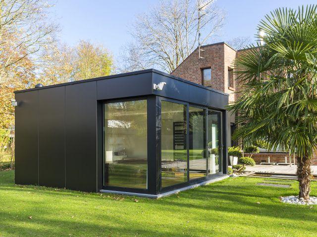 Extension de maison en aluminium et volkern (trespa)