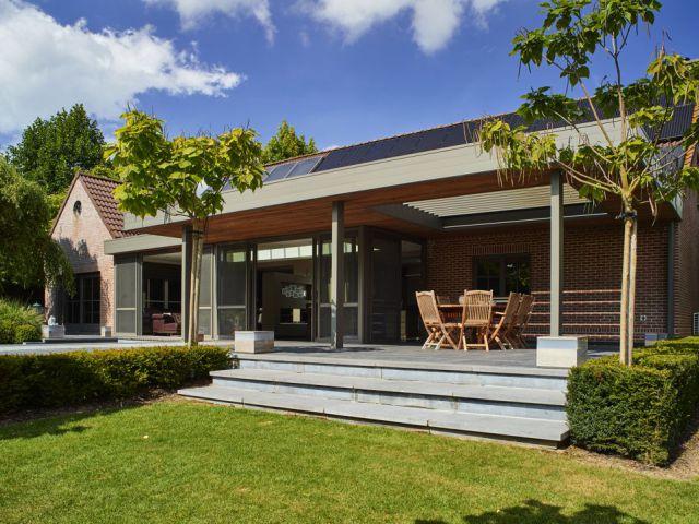 Extension véranda moderne avec toiture de terrasse