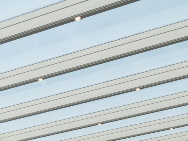 Véranda en aluminium avec spots encastrés