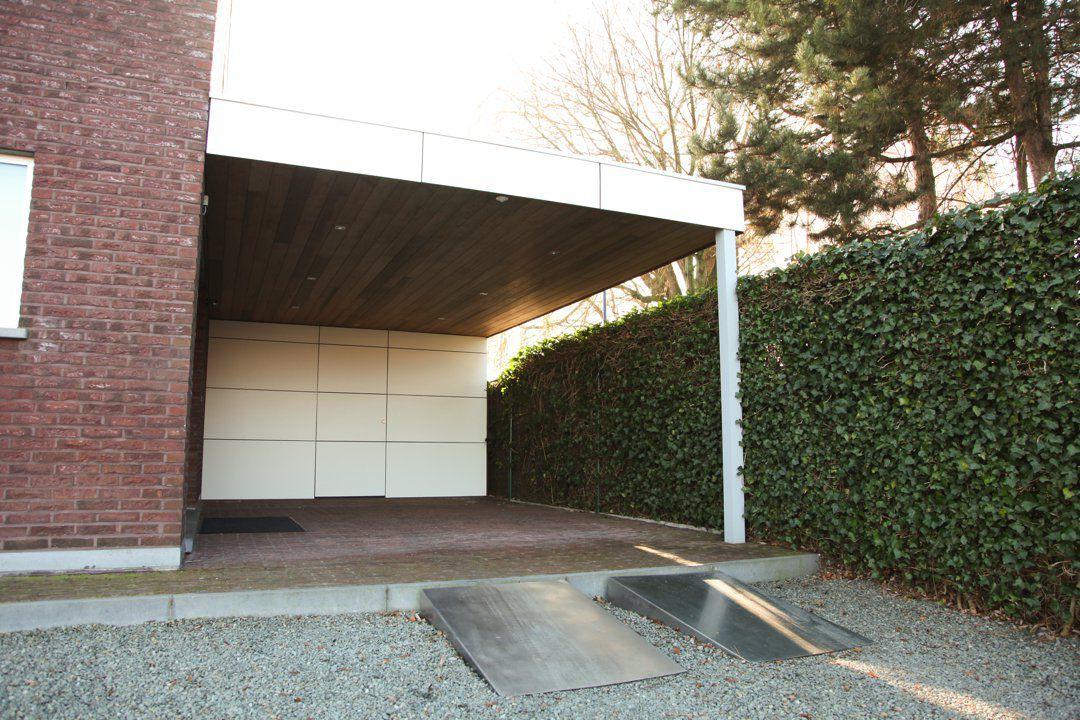carport met plat dak en berging in trespa